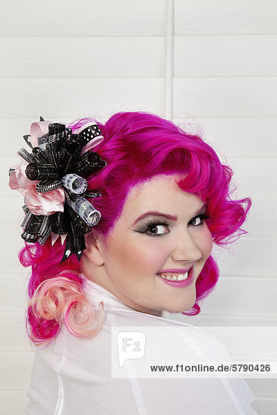 Portrait of a young woman wearing headgear looking back