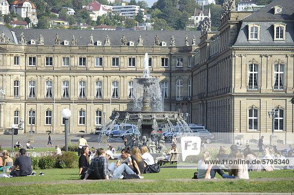 People sitting on Schlossplatz square  fountain  Stuttgart  Baden-Wuerttemberg  Germany  Europe