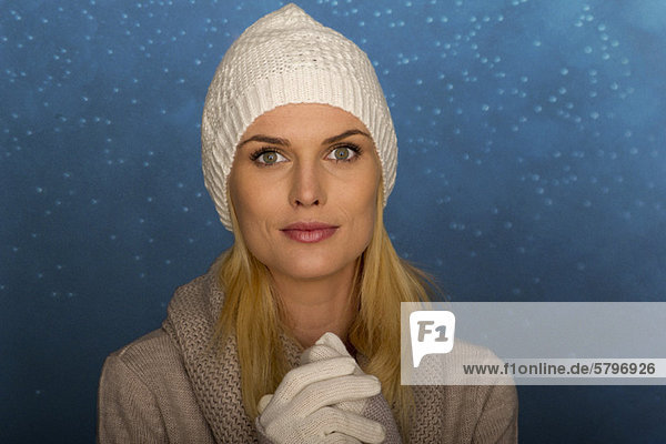 Woman wearing knit hat and gloves  portrait