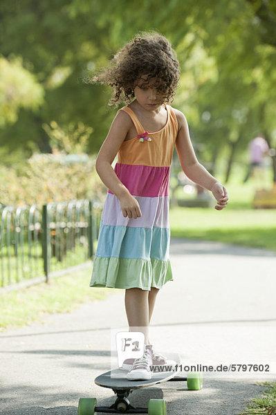 Girl standing on skateboard