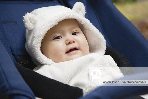 Baby girl wearing bear hood  portrait