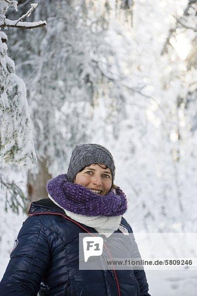Smiling woman in winter landscape  Bregenzerwald  Vorarlberg  Austria