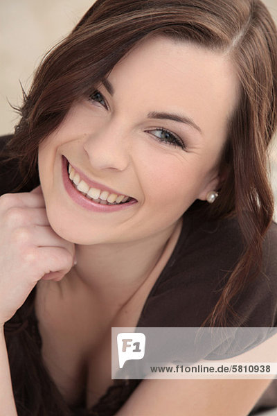 Smiling brunette young woman  portrait