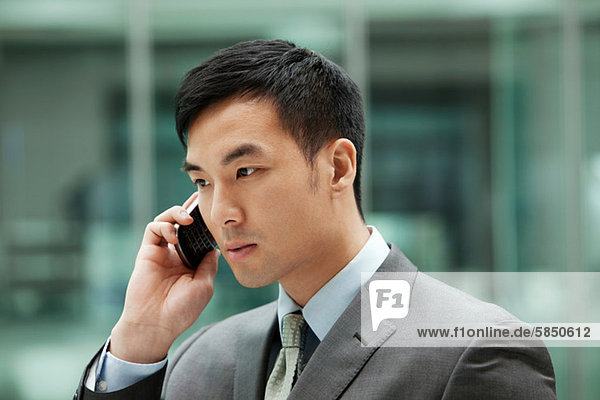 Young businessman on cell phone  portrait