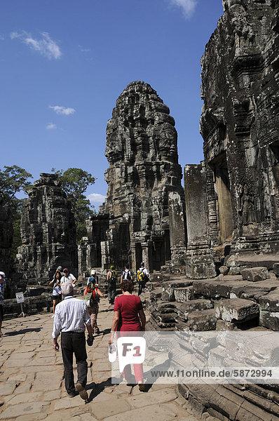 Tourists at the Bayon temple  Angkor  Cambodia  Asia