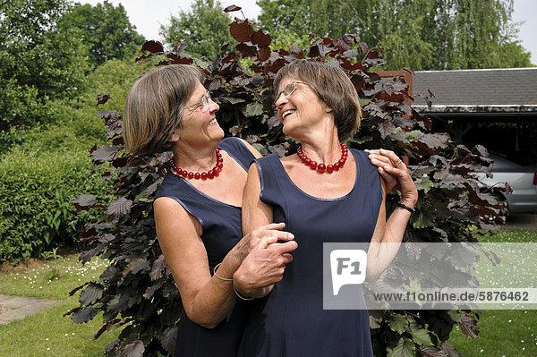 Lusty twin sisters  dressed alike