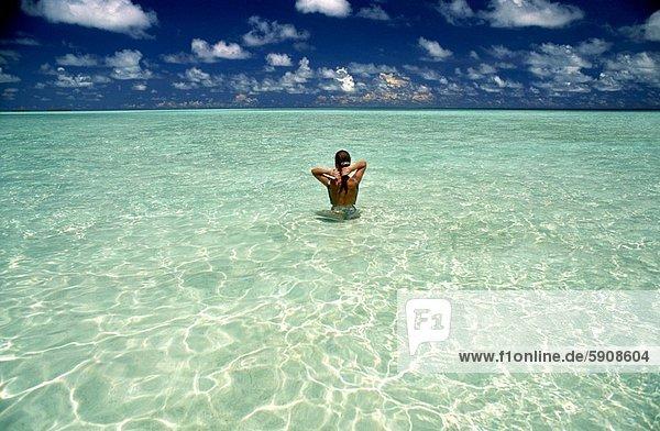 Rear view of a woman in water  Maldives. Rear view of a woman in water  Maldives