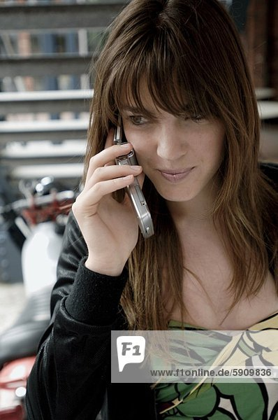 Close-up of a young woman talking on a mobile phone