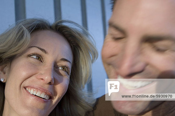 Close-up of a mid adult couple smiling. Close-up of a mid adult couple smiling