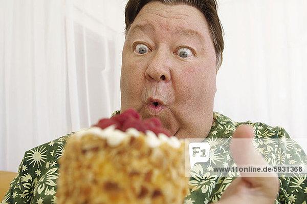 Close-up of a mature man looking at a cake. Close-up of a mature man looking at a cake