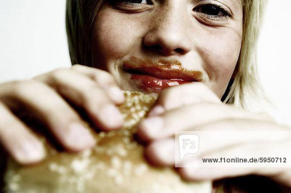 Close-up of a boy holding a burger. Close-up of a boy holding a burger