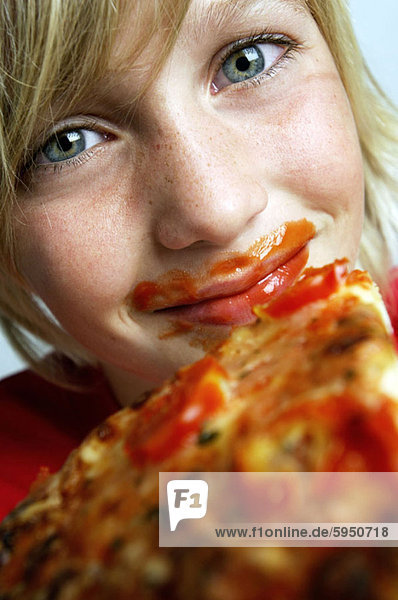 Close-up of a boy holding a pizza. Close-up of a boy holding a pizza
