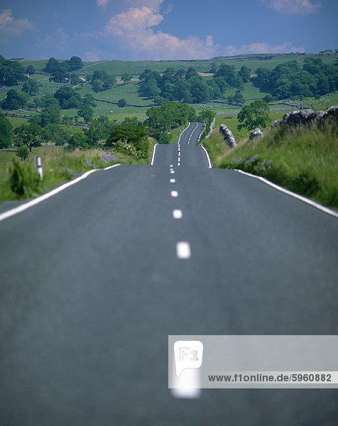 Undulating rural road through countryside  United Kingdom  Europe