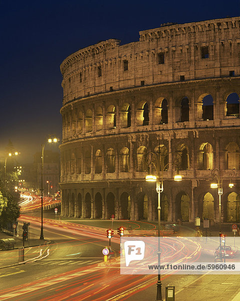 The Colosseum illuminated at night in Rome  Lazio  Italy  Europe
