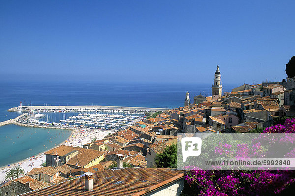 View across old town rooftops to harbour  Menton  Alpes-Maritimes  Cote d'Azur  Provence  French Riviera  France  Mediterranean  Europe