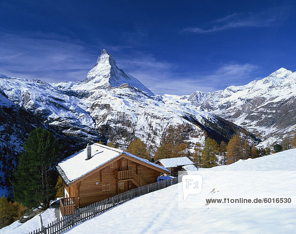 Chalets in a snowy landscape with the Matterhorn peak  near Zermatt  Swiss Alps  Switzerland  Europe