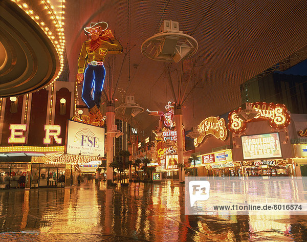 Reflections of neon lights and signs along Fremont Street in Las Vegas  Nevada  United States of America  North America