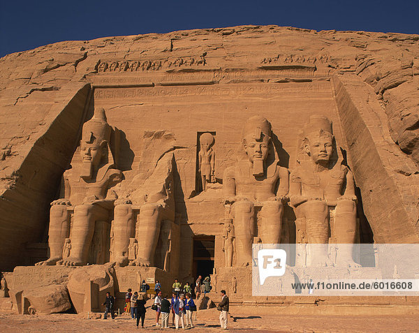 Tourists in front of the Temple of Re-Herakhte  built for Ramses II  also known as the Sun or Great Temple of Ramses II  Abu Simbel  UNESCO World Heritage Site  Nubia  Egypt  North Africa  Africa