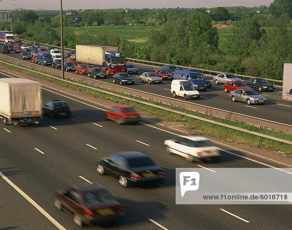 Lorries  vans and cars in a traffic jam on a motorway  United Kingdom  Europe