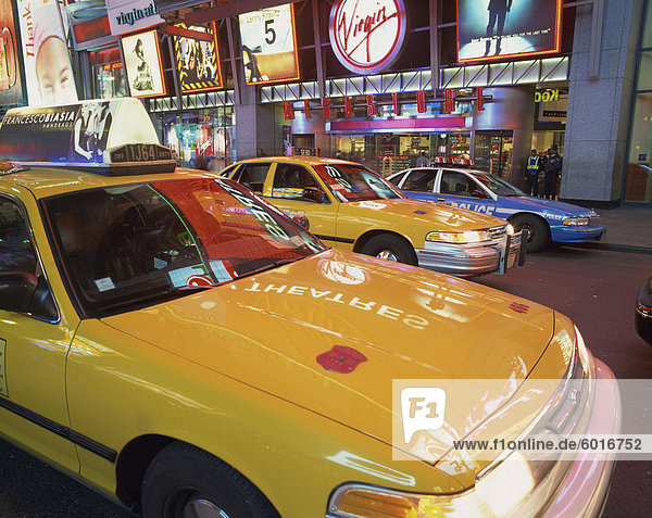 Yellow cabs on the street at night in Times Square  with Virgin Megastore in the background  in New York  United States of America  North America