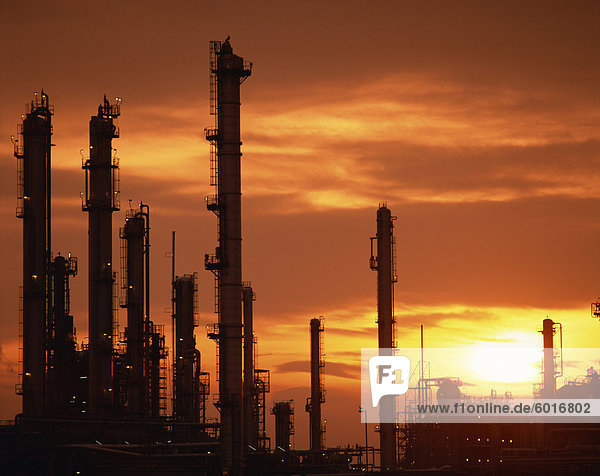 A petro-chemical plant in South Wales silhouetted against the sunset  Wales  United Kingdom  Europe