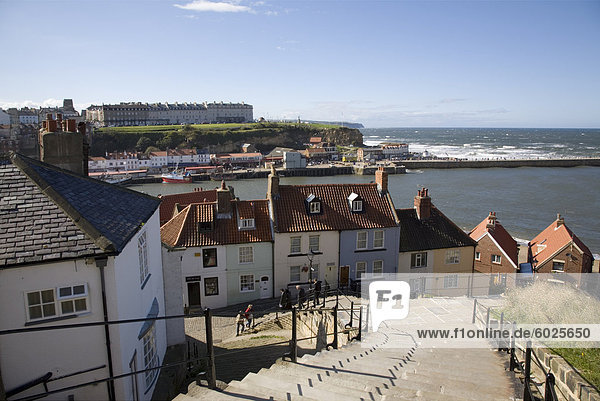Old Town and River Esk harbour from steps on East Cliff  with West Cliff beyond  Whitby  Heritage Coast of North East England  North Yorkshire  England  United Kingdom  Europe