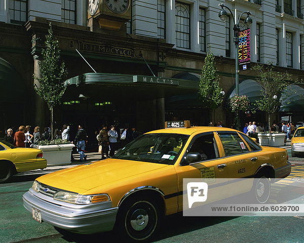 Yellow cabs outside Macy's Department Store in New York  United States of America  North America