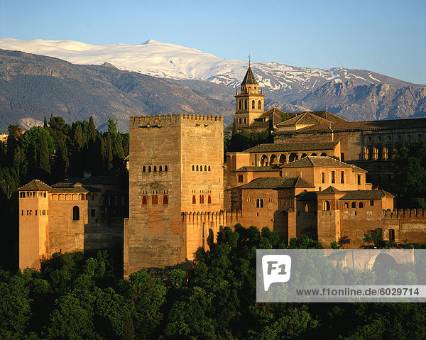 The Alhambra Palace  UNESCO World Heritage Site  with the snow covered Sierra Nevada mountains in the background  Granada  Andalucia  Spain  Europe