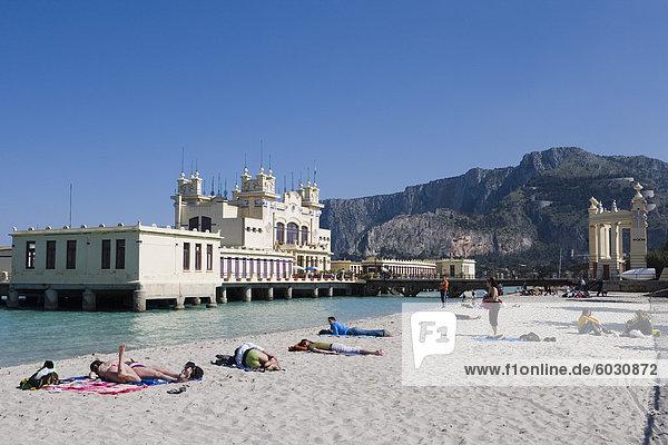 Sunbathers on beach near the pier  Mondello  Palermo  Sicily  Italy  Europe