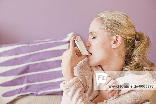Woman using inhaler