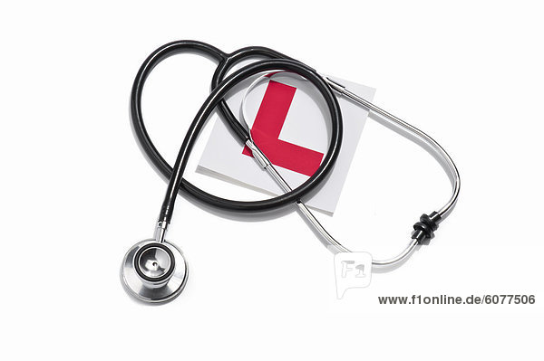 A doctors stethoscope and a Learners permit sticker
