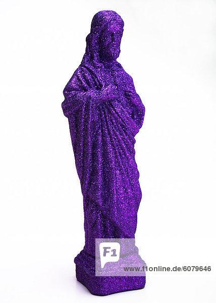 Eine lila Jesus Figur