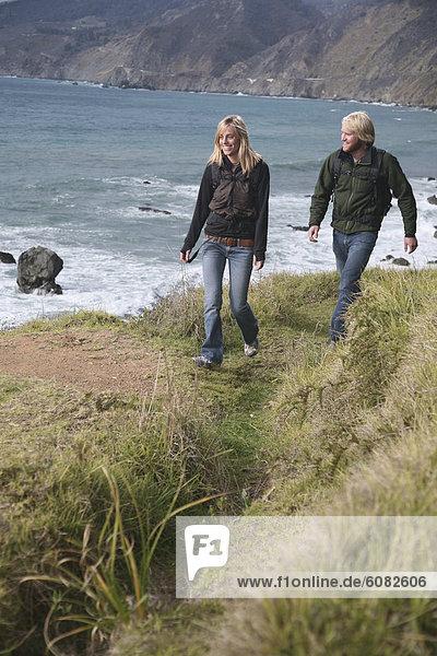 Couple hiking on the California coast.