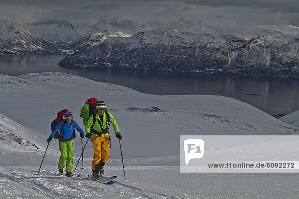 Norway  Lyngen  Skiers touring uphill