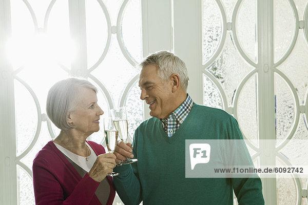 Germany  Berlin  Senior couple drinking champagne
