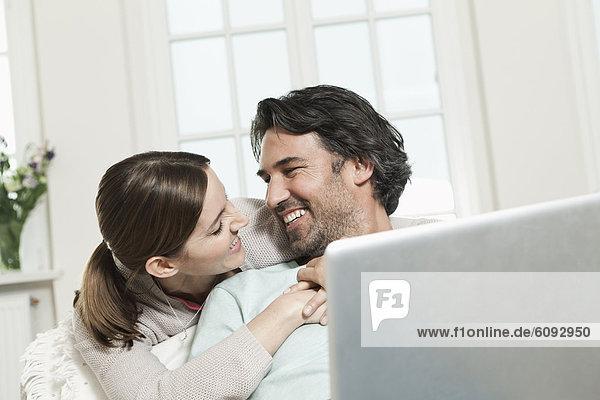 Germany  Berlin  Mature couple using laptop