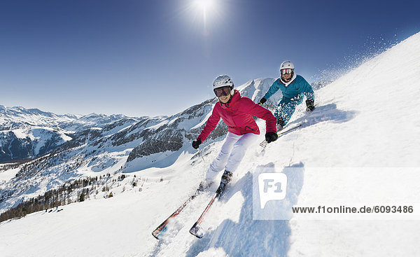 Austria  Salzburg  Young couple skiing on mountain