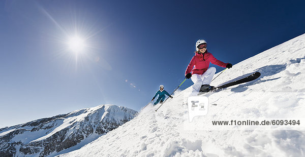 Austria  Salzburg  Young couple skiing on mountain