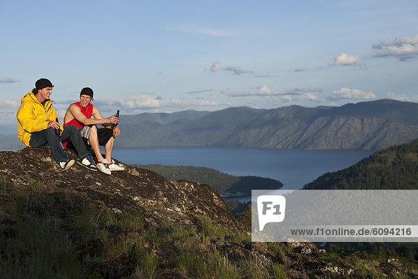 Two men enjoying the view after hiking in Idaho.