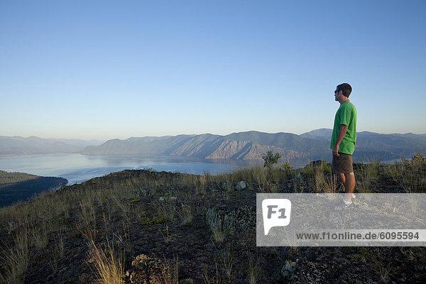 Young man hiking at sunset in Idaho.