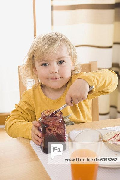 Girl having breakfast  smiling  portrait