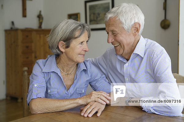 Germany  Bavaria  Senior couple looking at each other  smiling