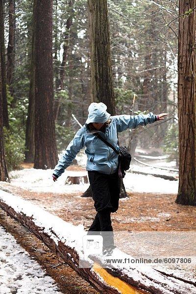 A woman walks through Yosemite National Park  California.