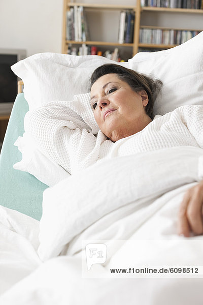 Senior woman relaxing on medical bed