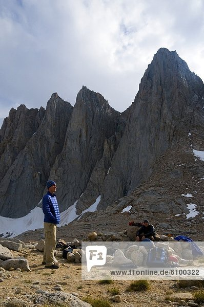 Two men hang out at camp below Mount Whitney in the Eastern Sierra  CA.