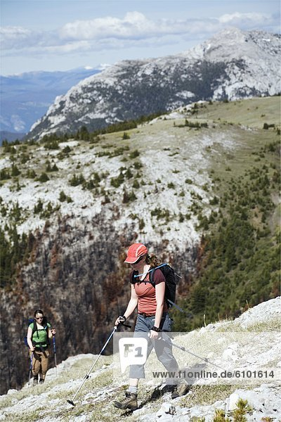 Two women hike on a broad ridge in the southern Chilcotin mountains.
