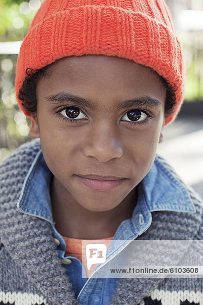 A portrait of a young boy taken in Harlem  New York.