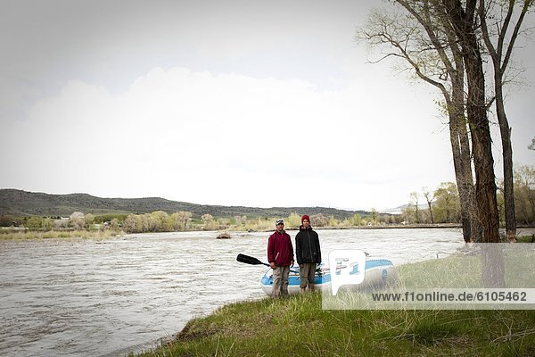 Two men stand by there raft in Montana.