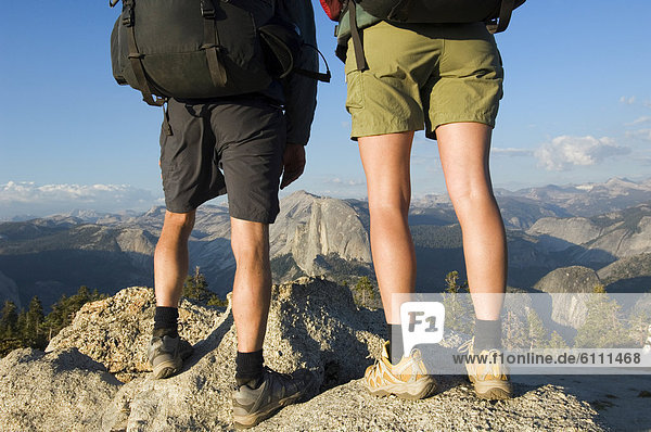 Hikers stand on rock on Sentinel Dome.