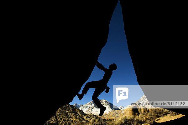 Mann  Silhouette  klettern